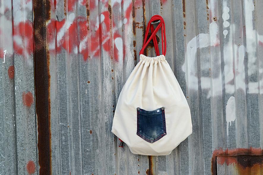 mochila saco de tela con bolsillo